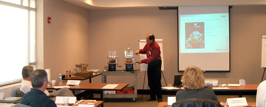 Dr. Lyle Branagan, Engineering Manager, demonstrating the effects of oil lubrication (click for larger version)